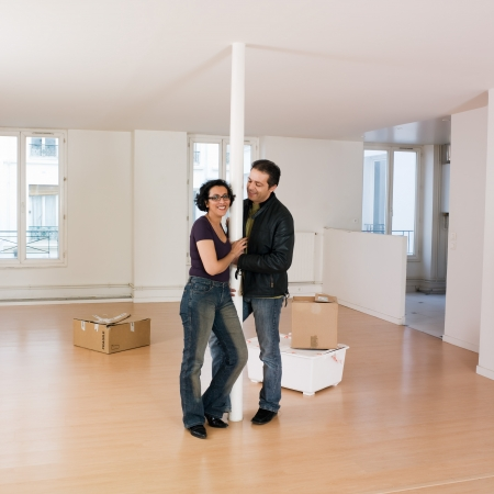 couple inside an empty loft appartement moving in photo