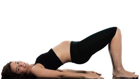 back exercise: pregnant caucasian woman workout exercise  isolated studio on white background