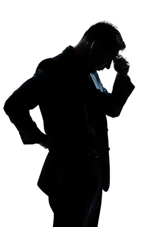 one caucasian man portrait silhouette thinking looking down in studio isolated white background photo
