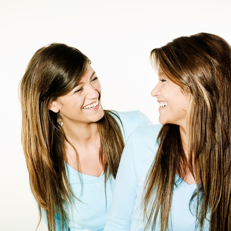 twin sister: studio shot portrait on isolated background of two sisters twins women friends
