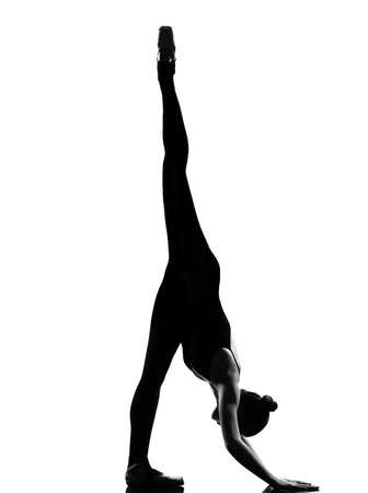 dancer legs: one beautiful caucasian tall woman ballet dancer exercising splits stretching warming up full length on studio isolated white background