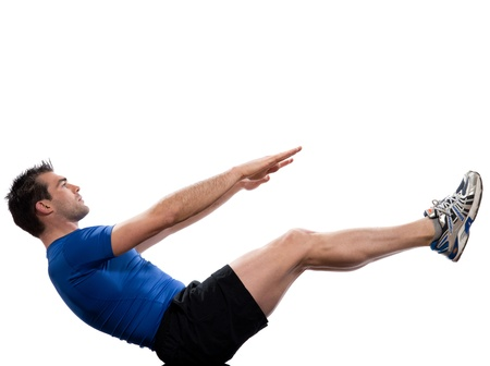 contracted: man on Abdominals workout posture on white background. Spice it up. This time bring your thighs to vertical and bend your knees to 45 degrees.  Now lift the shoulders from the floor, and keep the abdominal muscles continuously contracted. Lift your hands