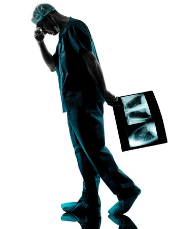 one caucasian man doctor surgeon radiologist medical worker silhouette isolated on white background Stock Photo - 16410135