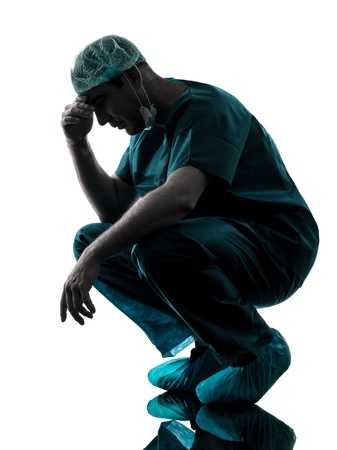 sideview: one caucasian man doctor surgeon medical worker despair fatigue tired  silhouette isolated on white background Stock Photo