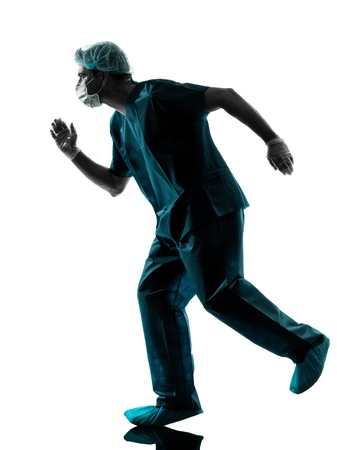 one caucasian man doctor surgeon medical worker running urgency  silhouette isolated on white background