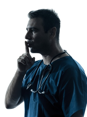 one caucasian man doctor surgeon hushing portrai medical worker silhouette isolated on white background photo
