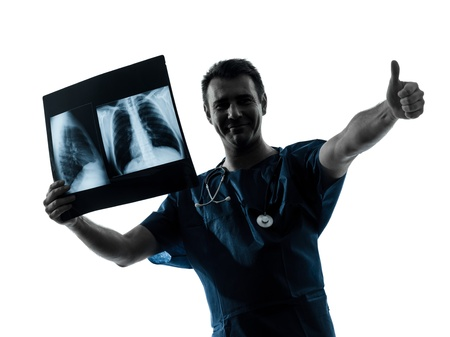 one caucasian man doctor surgeon radiologist medical thumb up examaning lung torso  x-ray image silhouette isolated on white background Stock Photo - 16410147