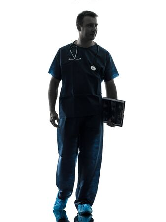 health care worker: one caucasian man doctor surgeon medical worker walking full length silhouette isolated on white background Stock Photo