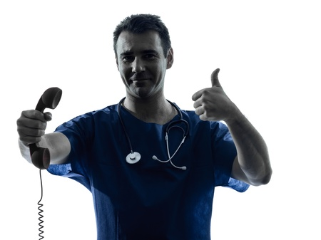 one caucasian man doctor surgeon medical worker  holding phone thumb up gesture silhouette isolated on white background Stock Photo - 16410153