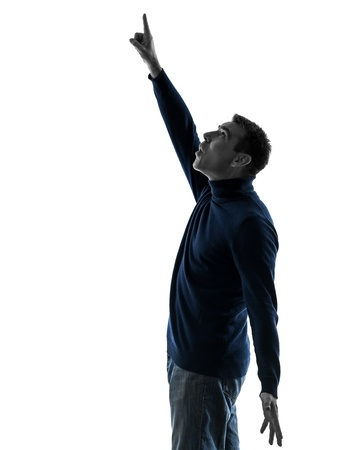one causasian man pointing up surprised  full length in silhouette studio isolated on white background photo