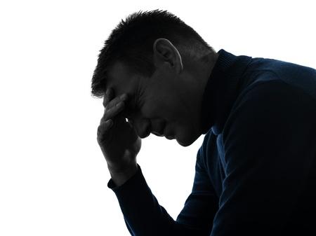 causasian: one causasian man headache pain portrait in silhouette studio isolated on white background Stock Photo