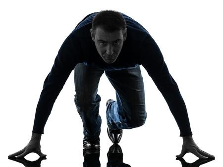 causasian: one causasian man starting blocks full length in silhouette studio isolated on white background