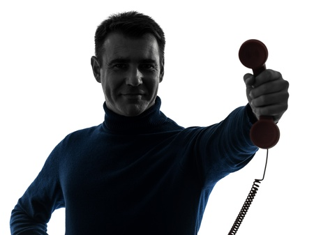 one causasian man on the phone portrait in silhouette studio isolated on white background Stock Photo - 16410140