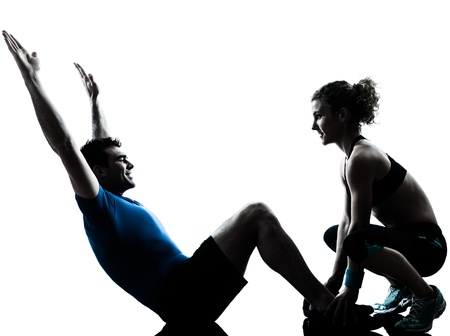 one caucasian couple man woman personal trainer coach exercising abdominal silhouette studio isolated on white background photo