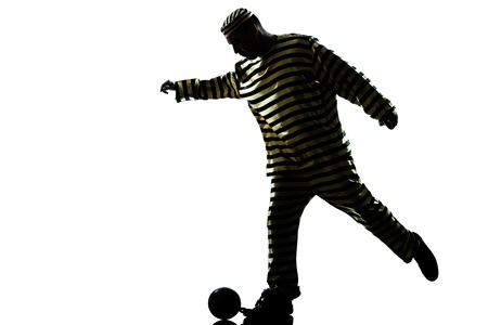 one caucasian man prisoner criminal playing soccer with chain ball in studio isolated on white background Stock Photo - 16410180