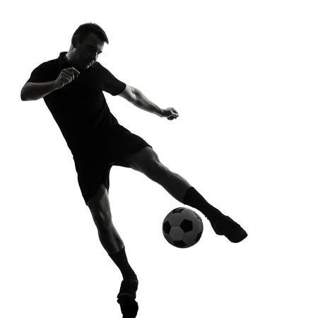 one man soccer player in studio silhouette isolated on white background photo