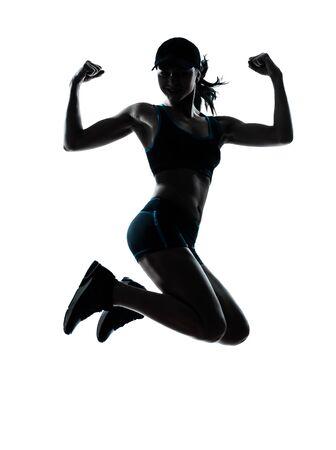 ジョグ: 白い背景で隔離のシルエット スタジオで強力なジャンプ 1 つの白人女性ランナー ジョガー