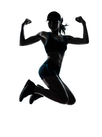 joggers: one caucasian woman runner jogger jumping powerful in silhouette studio isolated on white background