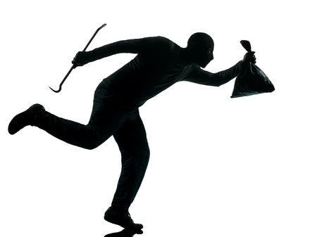 thief criminal running in silhouette studio isolated on white background in silhouette studio isolated on white background photo