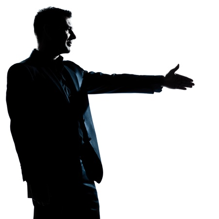 one caucasian man handshake profile portrait silhouette in studio isolated white background Stock Photo