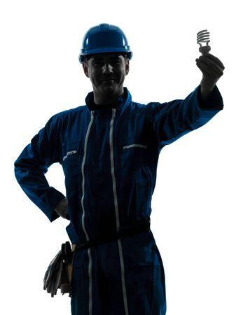 one caucasian man holding light bulb  silhouette in studio on white background photo
