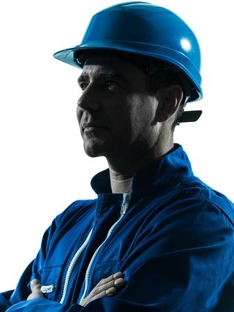 obreros trabajando: un hombre cauc�sico trabajador de la construcci�n silueta sonriente retrato en estudio en el fondo blanco
