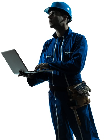 one caucasian man construction worker computing computer   silhouette portrait in studio on white background Stock Photo - 16410143