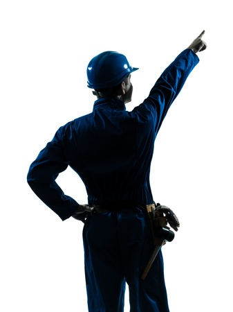 man looking out: one caucasian man construction worker pointing showing silhouette portrait in studio on white background