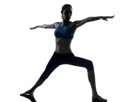 one caucasian woman exercising yoga in silhouette studio isolated on white background photo
