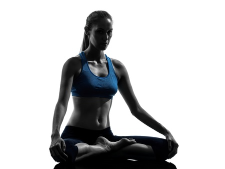one caucasian woman exercising yoga meditating in silhouette studio isolated on white background photo