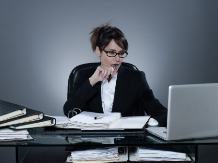 beautiful cheerful caucasian business woman working busy computing laptop computer sitting at desk on isolated background Stock Photo - 16543216