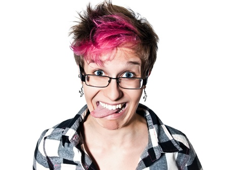 punk: Close-up portrait of a young expressive woman sticking out tongue in studio on white isolated background Stock Photo