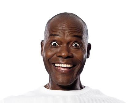 amazed: Close-up portrait of a surprised expressive Afro American mature man in studio on white isolated background Stock Photo