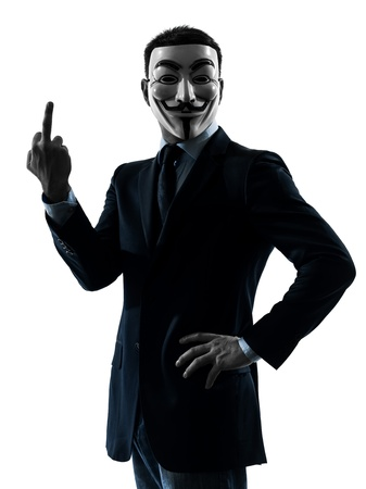 PARIS– OCTOBER 30 : one man dressed and masked as a  member of Anonymous underground group pointing finger on October 30, 2012 in Paris ,France