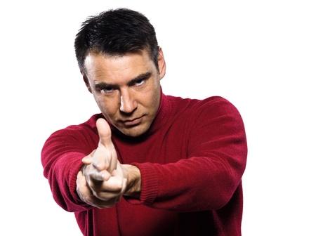 menacing: caucasian man gun gesture studio portrait on isolated white backgound