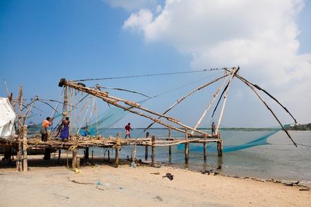 india fisherman: chinese fishing net of cochin in Kerala state india Editorial