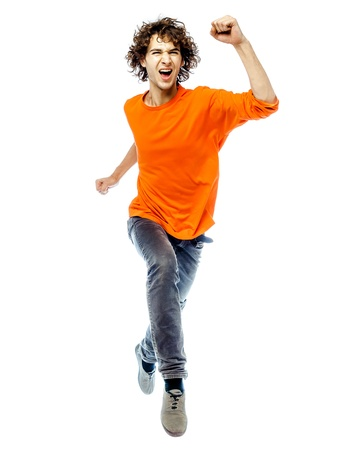 young unshaven: one young man caucasian running  screamming happy front view  in studio white background