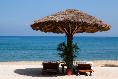 kovalam: deck chair by the sea in a hotel resort in Kerala state india