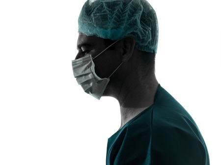 one caucasian doctor surgeon man portrait profile with face mask medical worker silhouette isolated on white background photo