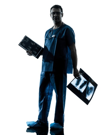 one caucasian man doctor surgeon radiologist medical worker silhouette isolated on white background Stock Photo - 16658541