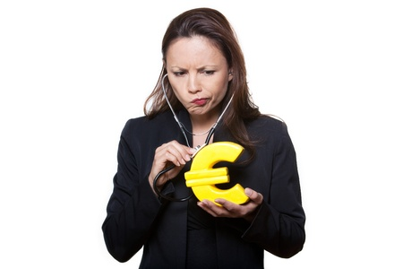 sulk: Portrait of beautiful expressive woman examining Euro in studio isolated on background
