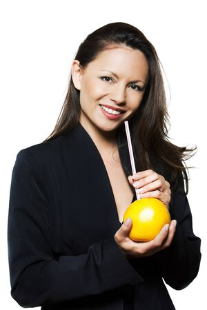 Portrait of beautiful Asian woman holding orange and straw in studio isolated on white background photo