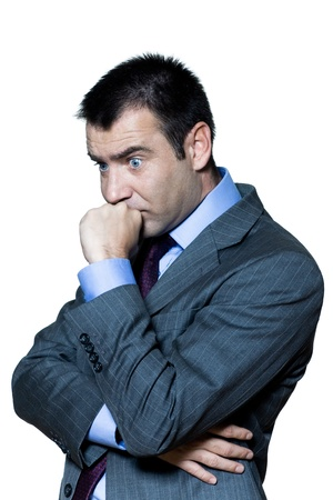 worried businessman: Portrait of a pensive shocked businessman in studio on isolated white background