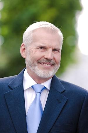 50 60 years: caucasian senior businessman portrait toothy smiling