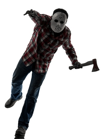 slayer: one causasian man serial killer with mask full length in silhouette studio isolated on white background Stock Photo