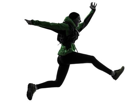 causasian: one causasian woman runner running trekking  in silhouette studio isolated on white background