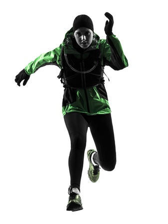 run out: one causasian woman runner running trekking  in silhouette studio isolated on white background