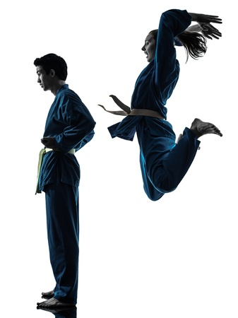 one  man woman couple exercising karate vietvodao martial arts in silhouette studio isolated on white background Stock Photo - 16716015