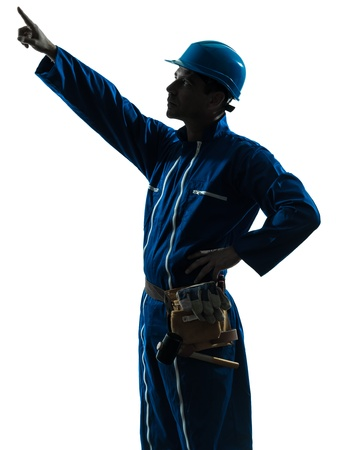 one caucasian man construction worker pointing showing silhouette portrait in studio on white background photo