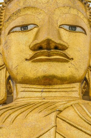 goldên buddha statue in the Wat Intharawihan Bangkok thailand photo